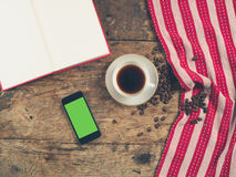 Coffee concept with cup, a book and a smart phone Royalty Free Stock Photo