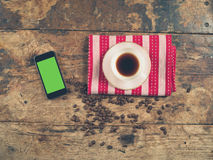 Coffee concept with cup and a smart phone Stock Image