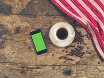 Coffee concept with cup and a smart phone Stock Photo