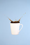 Coffee concept. Minimal art. Solid background. Coffee splashes. stock image