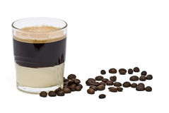 Coffee with condensed milk and beans. Royalty Free Stock Photo