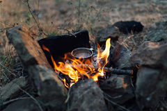 Coffee cooked over a campfire on  nature Stock Photos