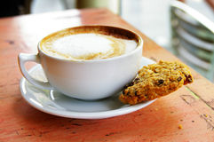 Coffee and cookie Stock Images