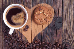 Coffee, cookie and heart Stock Photography