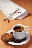 Coffee with cookie and newspaper Stock Photo