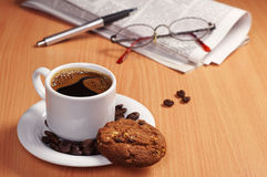 Coffee with cookie and newspaper Stock Image