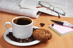 Coffee with cookie, newspaper and note Royalty Free Stock Photo