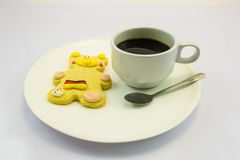 Coffee and cookie. This photo are coffee and cookie bear have Germany flag on body Stock Photo