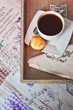 Coffee and cookie on tray Stock Images