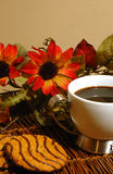 Coffee and cookies. With flowers Stock Image