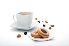 Coffee with cookies. Coffee with chocolate biscuits, nuts, almonds and raisins Royalty Free Stock Photography