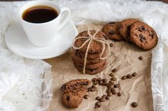 Coffee cookies with chocolate and a cup of black coffee royalty free stock image