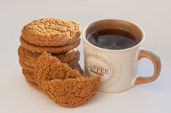 Coffee with cookies. Coffee and cookies closeup on the white background Royalty Free Stock Image