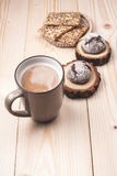 Coffee with cookies. Cup of coffee with cookies lying on the wooden table Stock Photography