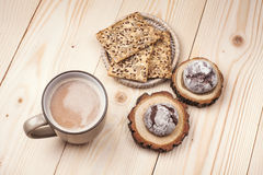 Coffee with cookies. Cup of coffee with cookies lying on the wooden table Royalty Free Stock Photo