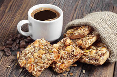 Coffee and cookies with different nuts Stock Images