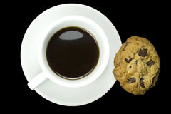 Coffee and cookies. Isolated on a black background Stock Photo