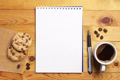 Coffee with cookies and notepad Royalty Free Stock Photography