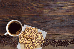 Coffee and cookies on old table Stock Photos