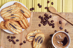Coffee and cookies with a poppy Royalty Free Stock Images