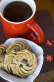 Coffee and cookies. Red cup of coffee with chocolate chip cookies Royalty Free Stock Photo