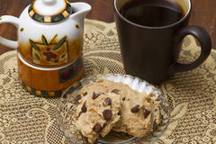 Coffee and Cookies. Coffee served with chocolate ship cookies and cream Stock Photography