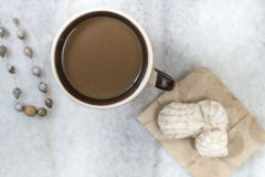 Coffee and cookies on table Stock Image