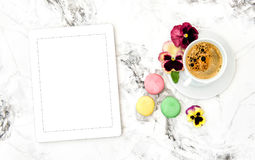 Coffee cookies tablet PC pansy flowers Floral flat lay Royalty Free Stock Photography