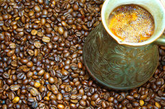 Coffee in a copper cezve and coffee beans Stock Image