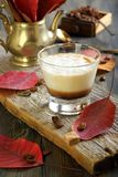 Coffee cortado and autumn leaves. Royalty Free Stock Images