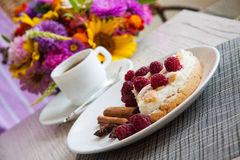 Coffee and cottage cheese quiche. Delicious cottage cheese quiche on plate Royalty Free Stock Photography