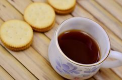 Coffee with crackers. Coffee with mini crackers Royalty Free Stock Image