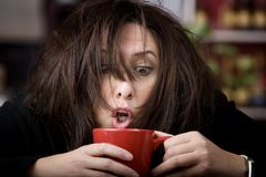 Coffee-Crazed Woman Royalty Free Stock Photos