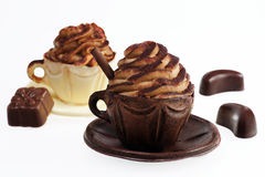Coffee cream. In decorative chocolate cups with chocolates Stock Photos