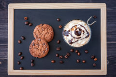 Coffee with cream and chocolate sauce   on the chalk board slate Royalty Free Stock Photography