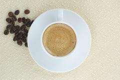 Coffee with cream and coffee beans Stock Images