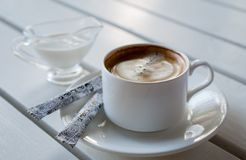 Coffee with cream Stock Images