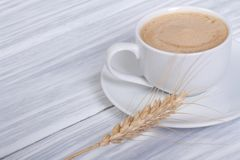 Coffee with cream and ears of barley Stock Photos