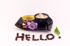 Coffee, Cream and Flowers. Coffee, cream,chocolate and fresh flowers on a white background and lettering Hello stock photo