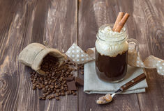 Coffee with cream. In jar on wooden background Royalty Free Stock Photography
