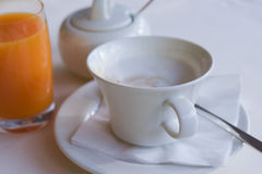 Coffee with cream and orange juice Stock Photo