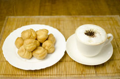 Coffee with cream puffs Stock Image