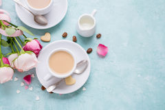 Coffee with cream and roses. Royalty Free Stock Photos