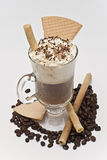 Coffee with cream and some wafers. A cup of coffee with cream and wafers royalty free stock photo