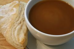 Coffee with cream and a turnover Royalty Free Stock Photos