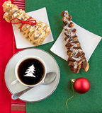 Coffee with cream, two croissants and shiny red ball. Royalty Free Stock Photos