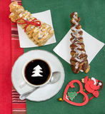 Coffee with cream, two croissants and vintage Christmas decoration. Royalty Free Stock Photography