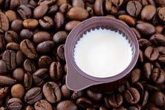 Coffee Creamer on coffee beans Stock Photos