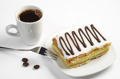 Coffee and creamy cake with chocolate Stock Image