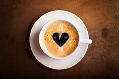 Coffee with creamy heart Stock Photos